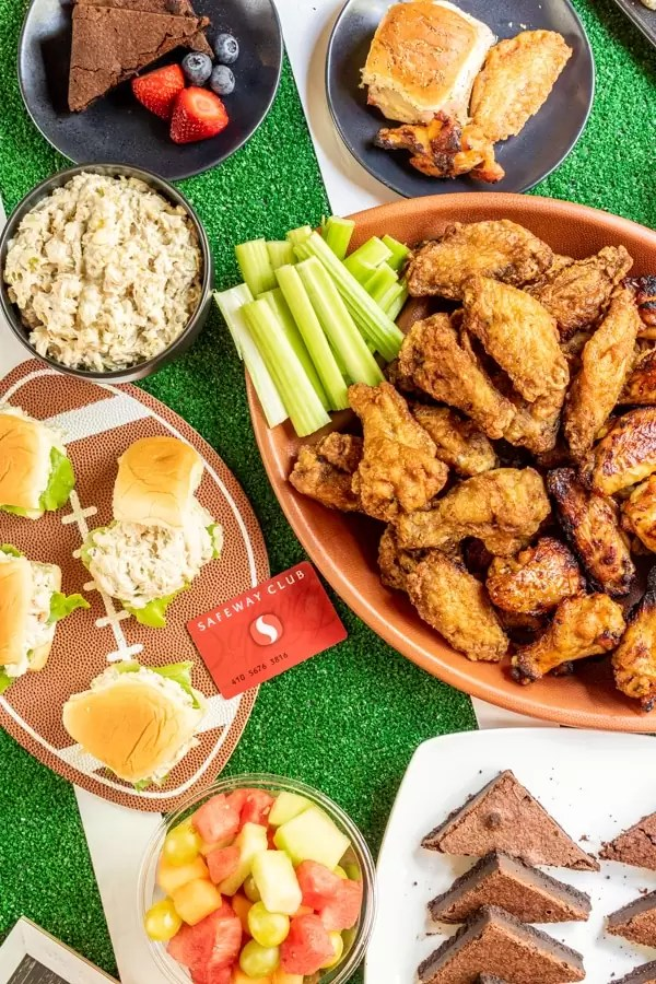 Top down view of football party food table  with Safeway Club card