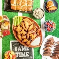 Game day food table with sliders, wings, and more