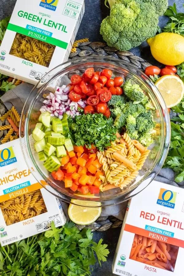 gluten free pasta and bowl of ingredients to make Vegan Pasta Salad