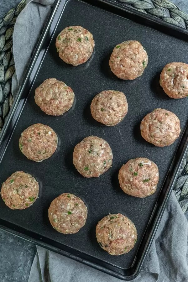 sheet pan with raw turkey meatballs