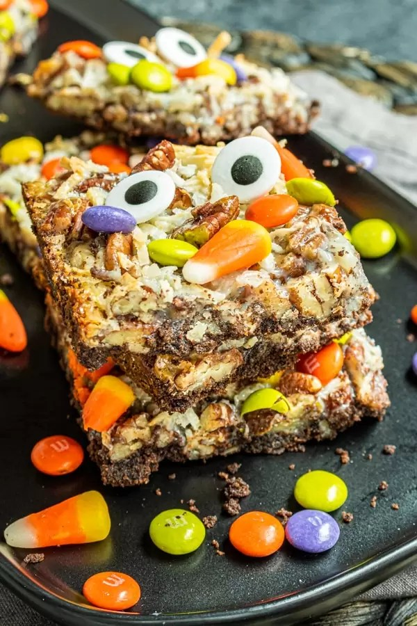 stacked Halloween Magic Cookie Bars on a plate