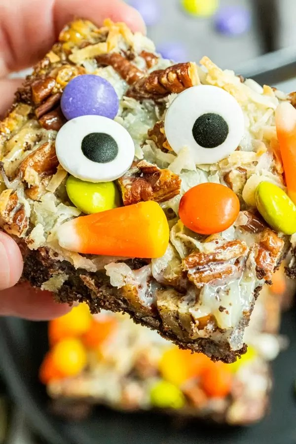 holding a Halloween Magic Cookie Bars