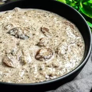 Keto Cream of Mushroom Soup in a black bowl