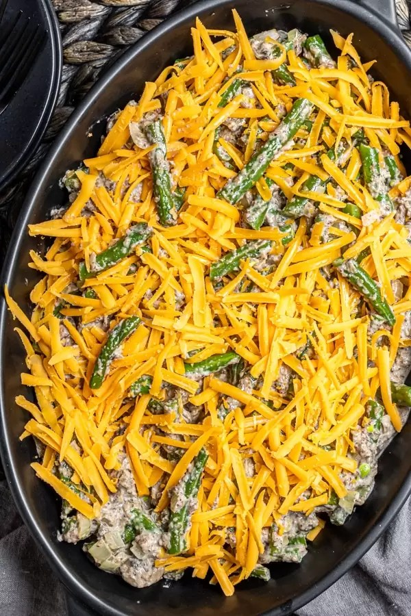 Keto Green Bean Casserole with cheddar cheese on top