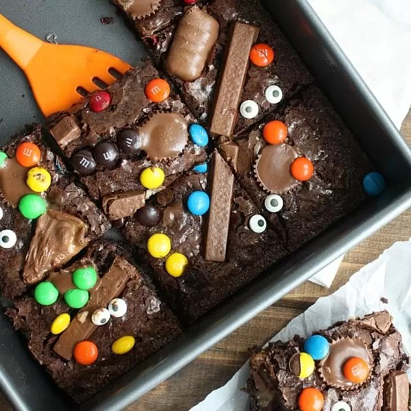 Spatula lifting brownie out of pan