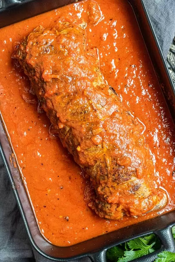 Beef Braciole covered in sauce