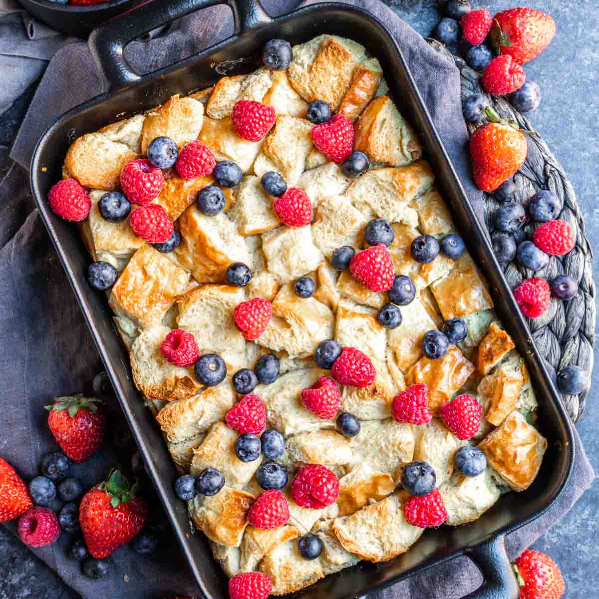 platter with Overnight French Toast Bake topped with fresh berries