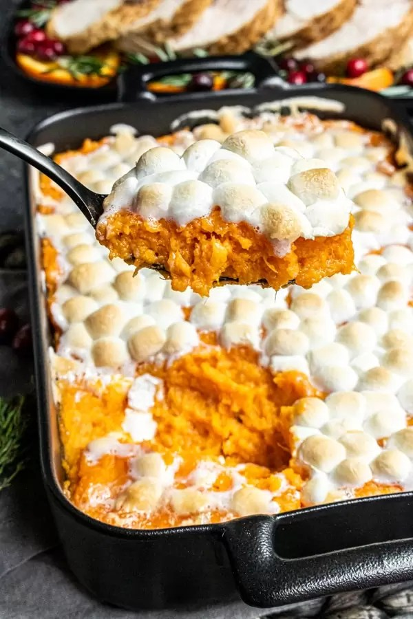 serving Sweet Potato Casserole with Marshmallows for Thanksgiving