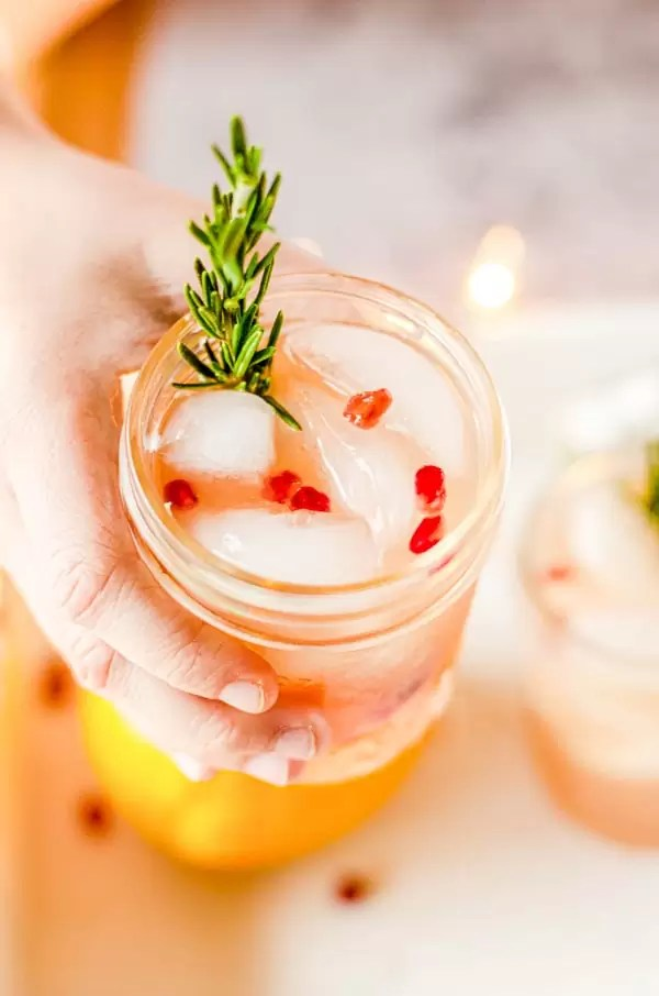 holding Christmas Punch in a mason jar