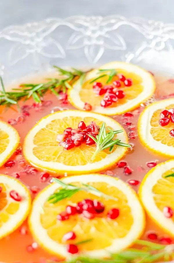 orange slices on top of Christmas Punch bowl