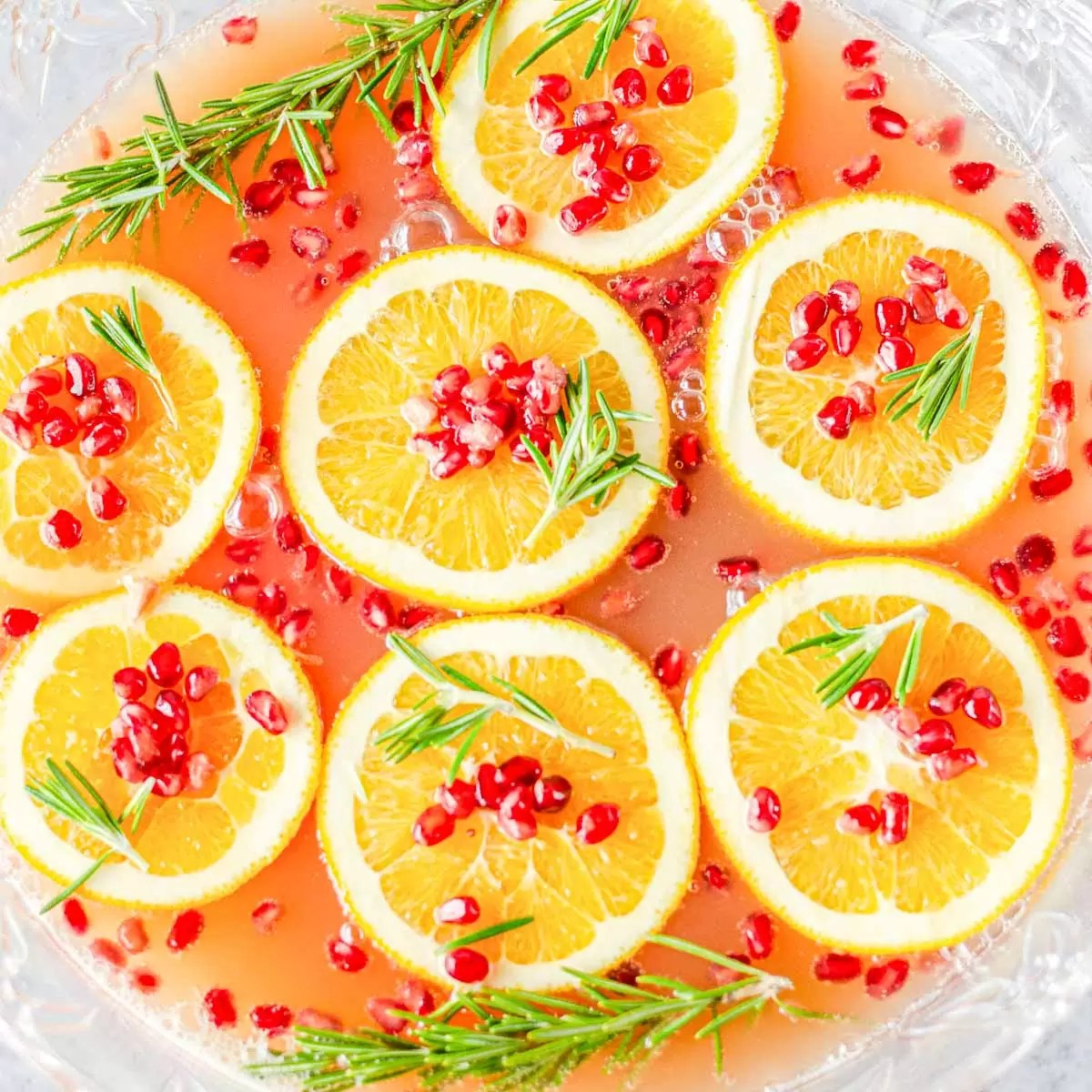 punch bowl with Christmas Punch with floating orange slices