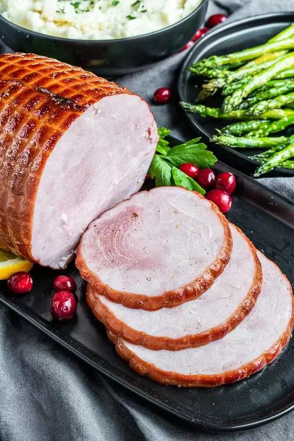 black platter with Instant Pot Ham sliced