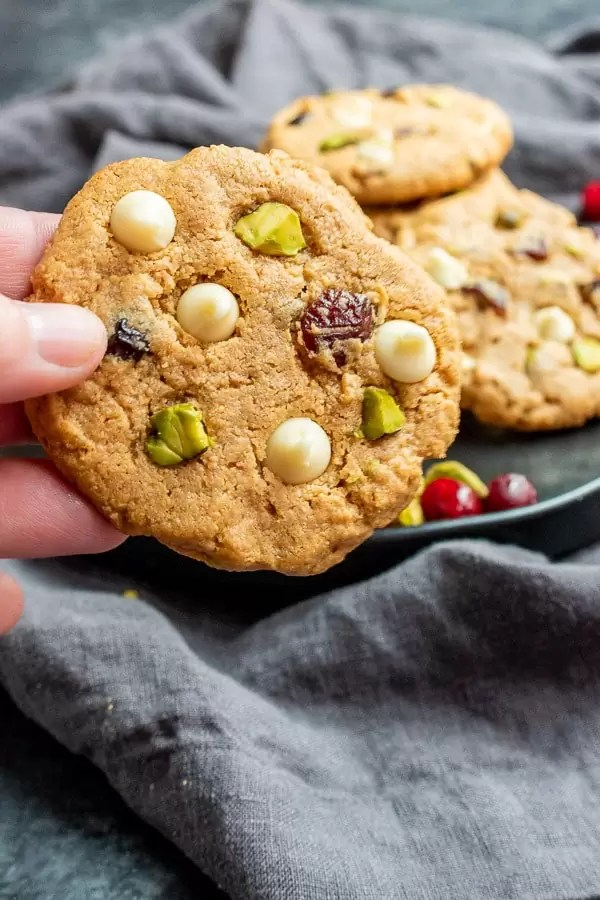 holding Keto Pistachio and Cranberry Cookies