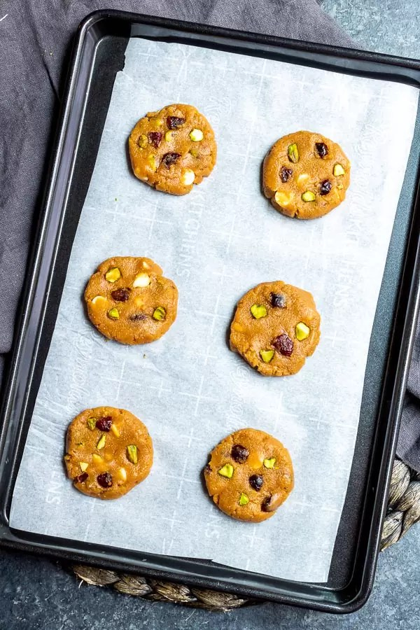 raw Keto Pistachio and Cranberry Cookies on sheet pan