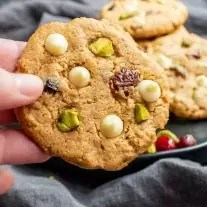 holding a Keto Pistachio and Cranberry Cookies