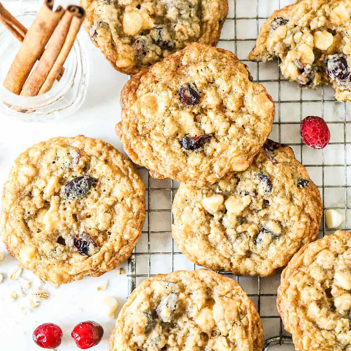 Top down shot of White Chocolate Oatmeal Cranberry Cookies on a cookie rack