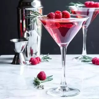 Raspberry Martini garnished with raspberries