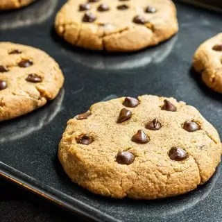 Keto Peanut Butter Cookies with Chocolate Chips on a black sheet pan