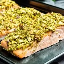 Close up of a pieces of pistachio crusted salmon