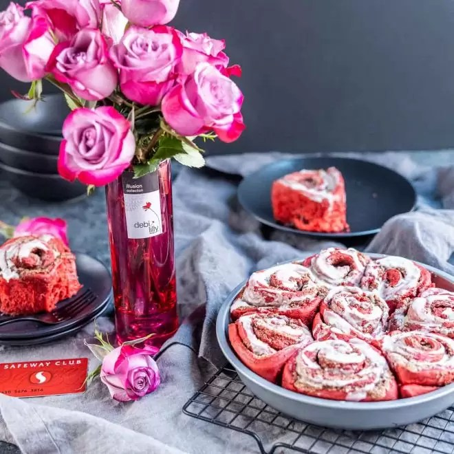 roses in a vase with Red Velvet Cinnamon Rolls