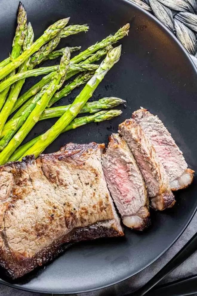 Air Fryer Steak slice on a black plate