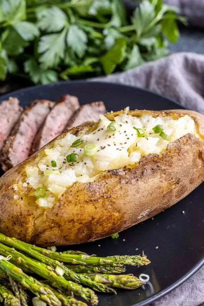 Instant Pot Baked Potatoes topped with butter and chives