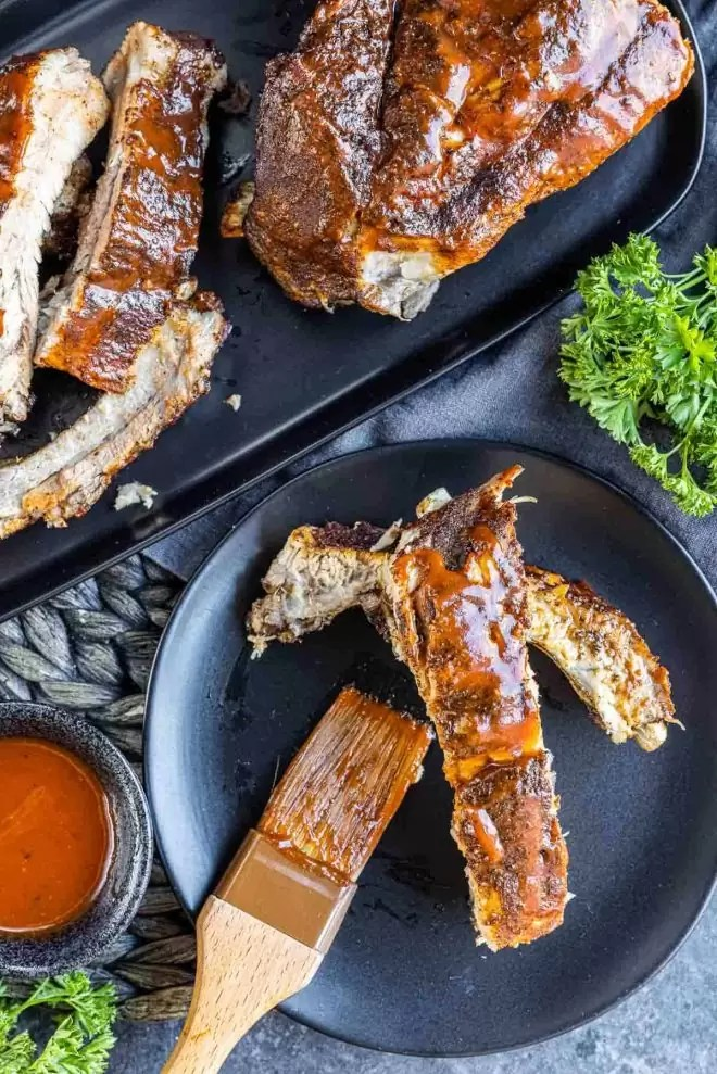 Instant Pot Ribs on a plate with a brush