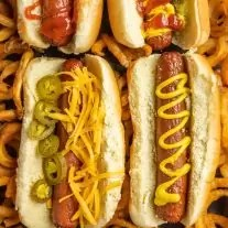 Air Fryer Hot Dogs on a platter with fries