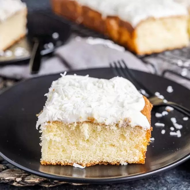 piece of Coconut Sheet Cake on a plate