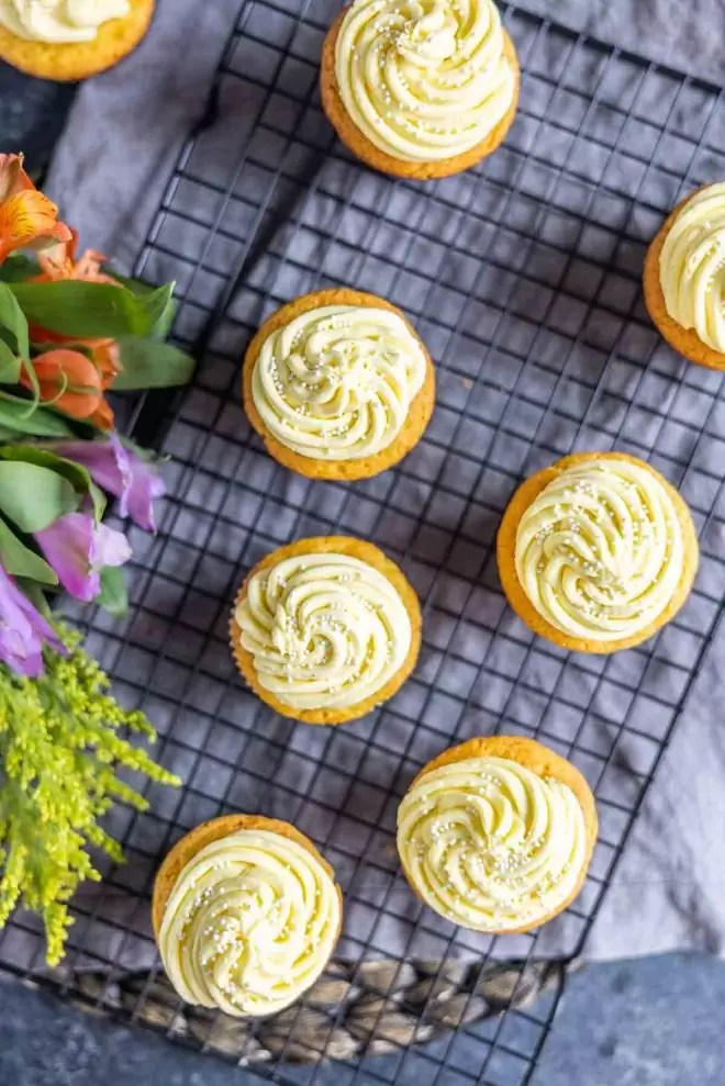 top down of several lemon cupcakes on a cool rack