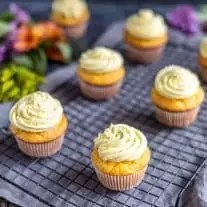 Lemon cupcakes on a cooling rack