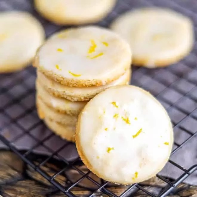 Lemon Shortbread Cookies stacked on cooling rack