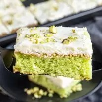 black serve with a piece of Pistachio cake