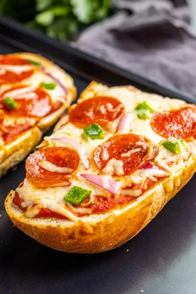 French Bread Pizza topped with pepperoni and peppers