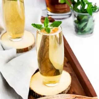 Mint Julep on a wooden tray garnished with mint