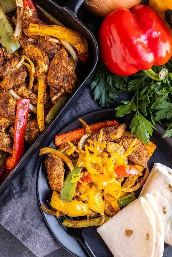 Oven Chicken Fajitas on a plate with tortillas