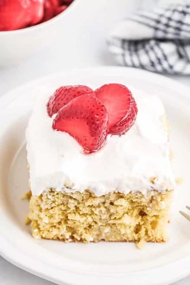 Tres Leches Cake with frosting and strawberries