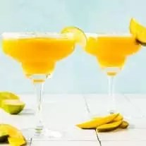 two Mango Margaritas in glasses with salted rim