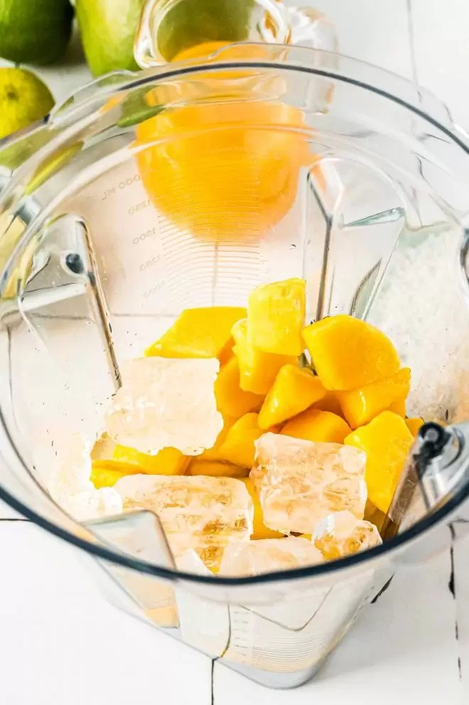 Mango Margarita pieces and ice in blender
