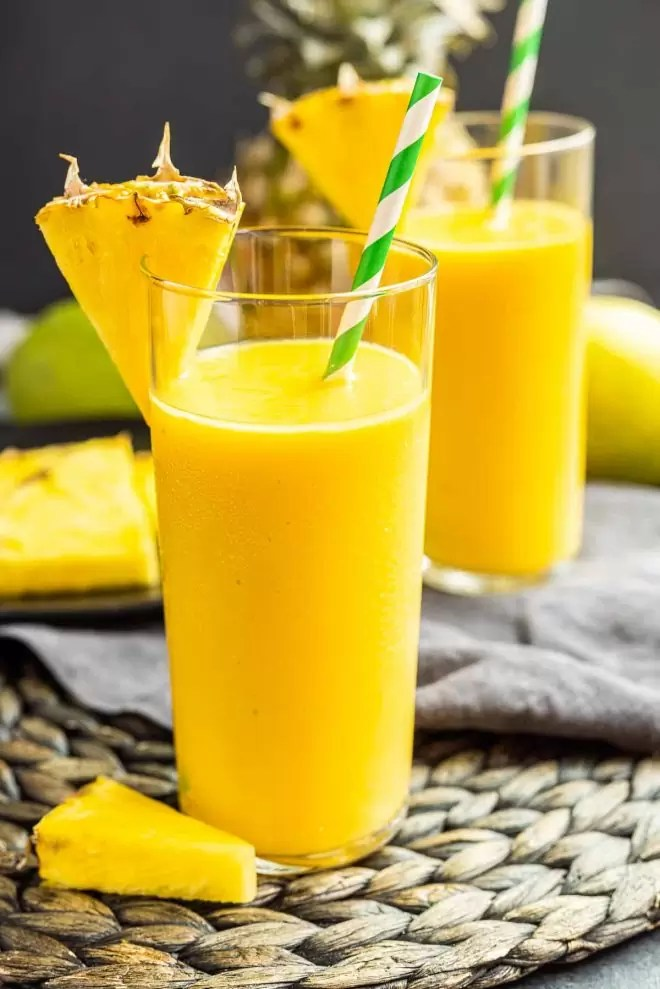 Mango Pineapple Smoothie with pineapple wedge
