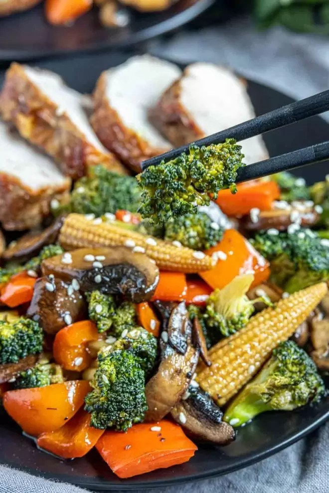 chopsticks holding Vegetable Stir Fry