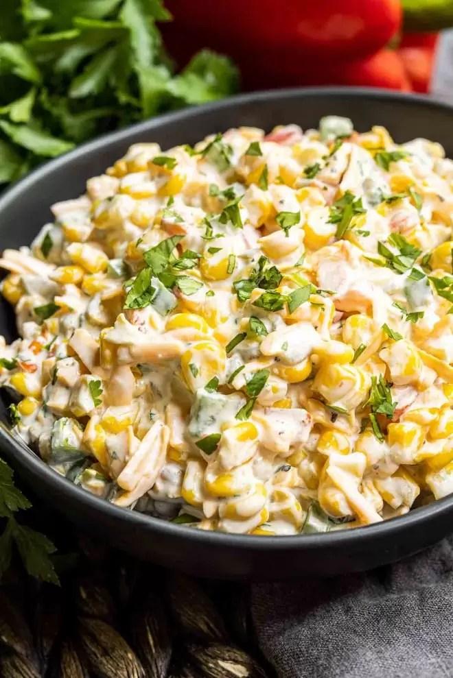 black bowl of Creamy Jalapeno Corn Dip appetizer
