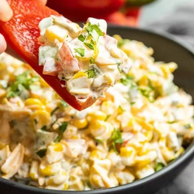 red pepper slice with Creamy Jalapeno Corn Dip on it