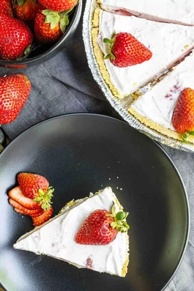 Frozen Strawberry Pie slice on a plate with whole pie next to it