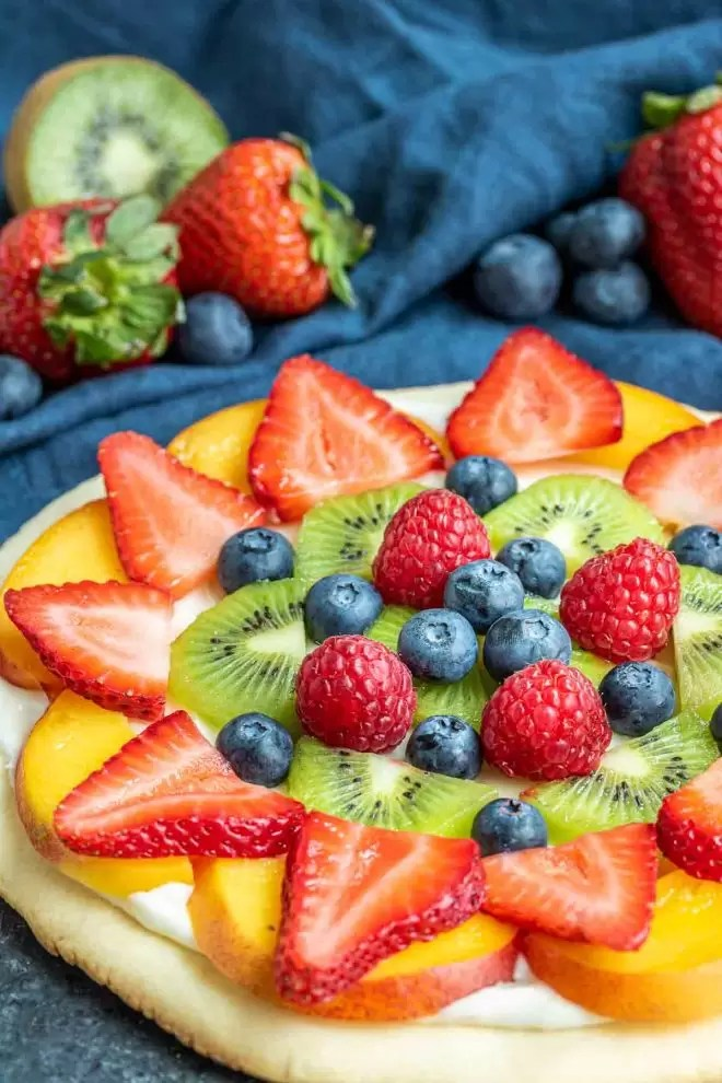 Fruit Pizza layered with fruit on top