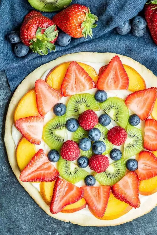 Fruit Pizza dessert topped with fresh fruit