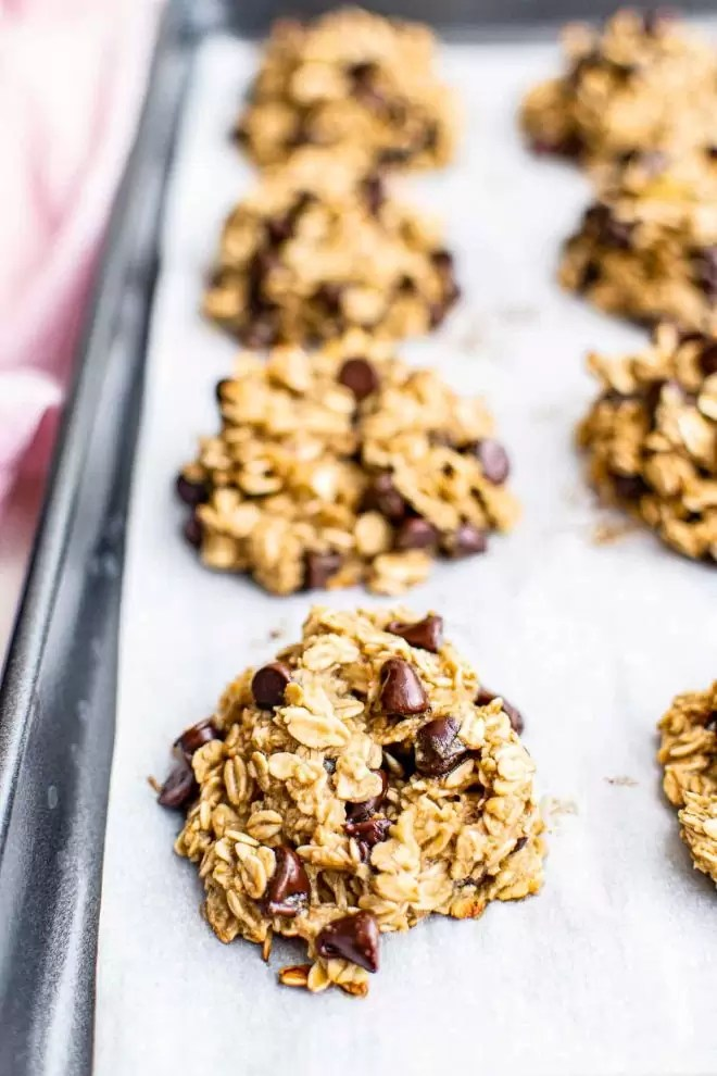 Healthy Oatmeal Cookies on wax paper on cookie sheet