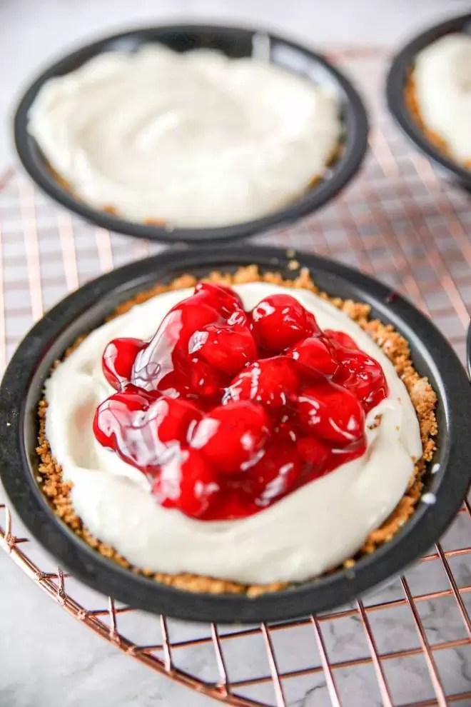 mini No Bake Cherry Cheesecake on cooling rack