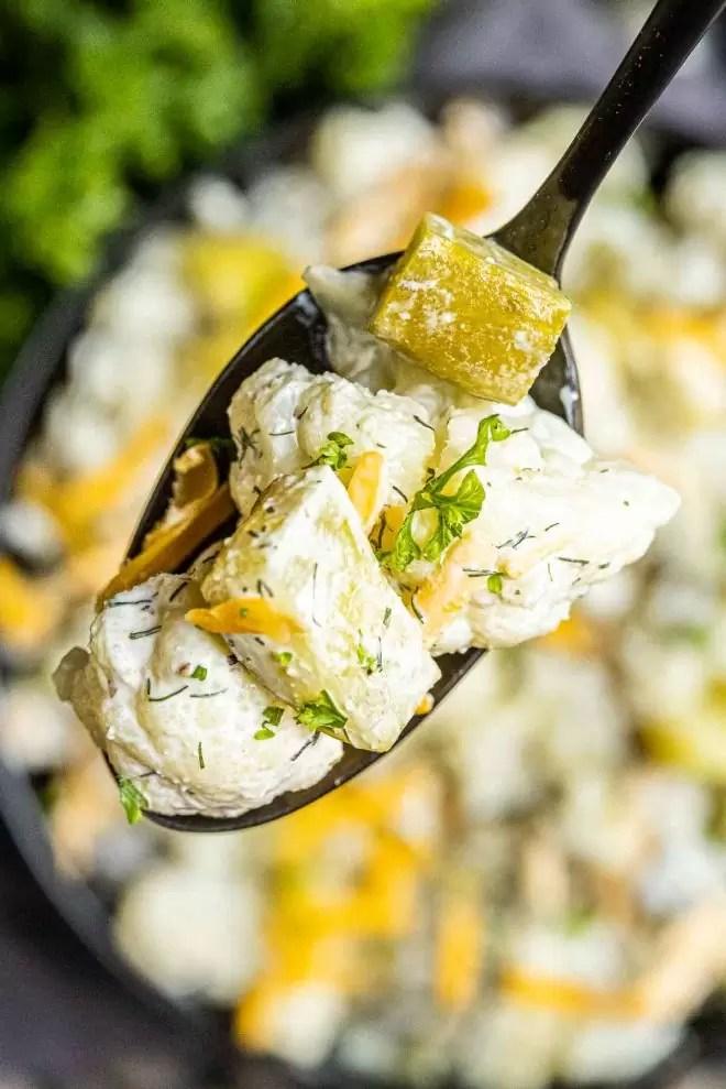 Keto Dill Pickle Salad on a black spoon