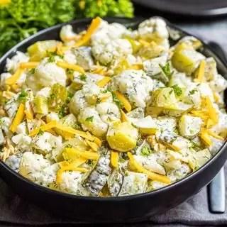 Keto Dill Pickle Salad in a black bowl